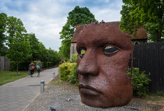 Bulkhead or the mask sculpture Canterbury Kent. Canterbury, Kent, England - May 15 2017: The face Mask or Bulkhead art created by Rick Kirby , British sculptor stock photos
