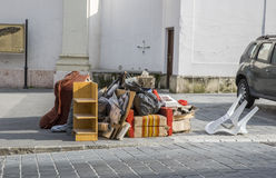 Bulky waste on the street. Broken beds, garbage furniture on pavement ready for bulky waste collection. Stock Photo