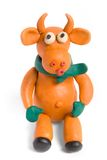 Bull. Orange bull (symbol of 2009) made with plasticine isolated on white stock image