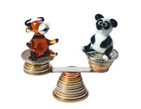 Bull and bear balancing with coins Royalty Free Stock Image