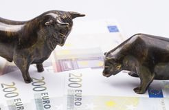 Bull and bear on banknotes stock image