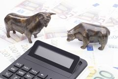 Bull and bear with calculator royalty free stock photography