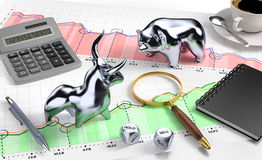 Bull and Bear on Desktop Stock Market. Metallic statuettes of a bull and a bear, standing opposite each other on a desk. Illustration on the subject of Stock Royalty Free Stock Photography