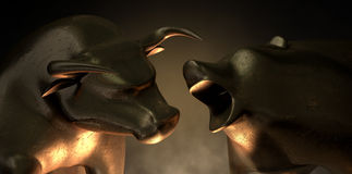 Bull And Bear Market Statues. An abstract closeup of two gold cast statuettes depicting a stylized bull and a bear in dramatic contrasting light representing a Royalty Free Stock Photography