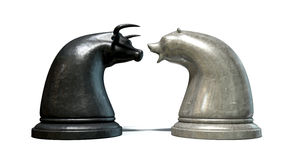 Bull And Bear Market Trend Chess Pieces. Two contrasting metal chess pieces depicting a stylized bull and a bear opposing each other representing financial stock illustration