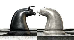Bull And Bear Market Trend Chess Pieces. Two contrasting metal chess pieces depicting a stylized bull and a bear opposing each other representing financial Royalty Free Stock Photo