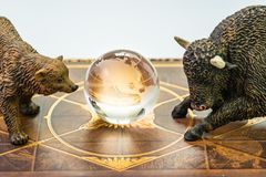 Bull and bear market, world stock exchange symbol for high and low season concept, bear and bull figures with the shinny globe. With US America map in the stock photo