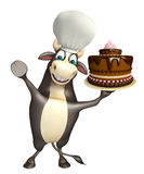 Bull cartoon character with cake and chef hat Stock Photos