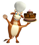 Bull cartoon character with cake and chef hat Royalty Free Stock Photos