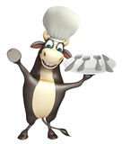 Bull cartoon character with chef hat and dinner plate Stock Photo