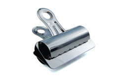 Bull Clip. Big Shiny metal Bull Clip isolated on a white background stock images