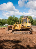 Bull Dozer. Clearing A Field On A Sunny Day Stock Photography