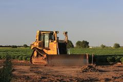 Bull Dozer in a field at a work site Royalty Free Stock Photo