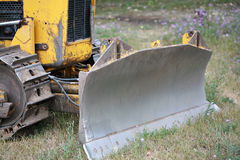 Bull dozer plow. Bull dozer front end, with the plow most prominent Stock Photography