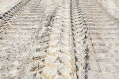 Bull Dozer and Truck Tracks in Sand stock photo