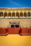 The bull fighting ring at Seville, Spain, Europe. Balcony Crowd stand at The bull fighting ring at Seville, Spain, Europe on a bright sunny day with clear blue Royalty Free Stock Image
