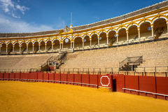 The bull fighting ring at Seville, Spain, Europe. On a bright sunny day with blue skies Stock Images