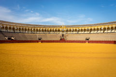 The bull fighting ring at Seville, Spain, Europe. The central view of the empty stand and balcony of the bull fighting ring at Seville, Spain, Europe Stock Images