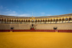 The bull fighting ring at Seville, Spain, Europe. A view of the pavillion at the bull fighting ring at Seville, Spain, Europe on a bright sunny day with blue Stock Photos