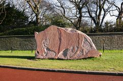 Bull figure. A marble bull figure in Holyrood Park in Scotland, Edinburgh Royalty Free Stock Photo