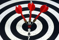 Bull's Eye. Three red darts hitting a target board, concept for success Royalty Free Stock Photography