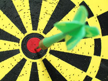 Bull's Eye. Close-up of a dart on the bull's eye of a board royalty free stock photos