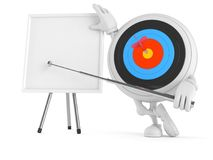 Bull`s eye character with whiteboard. On white background Stock Photos