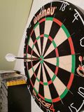 Bull`s eye with a dart on a board which scores 50 points in a game. royalty free stock images