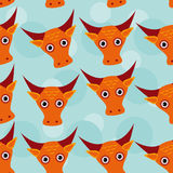 Bull Seamless pattern with funny cute animal face on a blue back Stock Photos