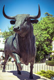 Bull statue in front of the bullfighting arena in Ronda, Spain Royalty Free Stock Photography