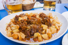 Bull tail stew with fried potatoes. Stock Photos