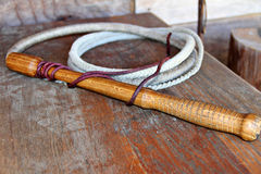 Bull whip. Shot of a leather Bull whip on wood Stock Photography
