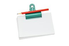 Bulldog clip holding loose memo papers Royalty Free Stock Photos