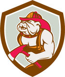 Bulldog Fireman With Axe Shield Retro. Illustration of a bulldog fireman firefighter holding axe facing side set inside shield crest on isolated background done Royalty Free Stock Images