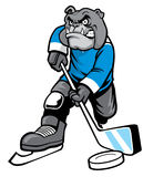 Bulldog playing ice hockey Royalty Free Stock Photos