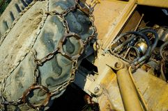 Bulldozer. With closeup to wheel and engine stock images