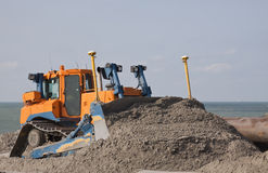 Bulldozer. A Bulldozer on Hollands lardge Dredging work Maasvlakte royalty free stock images