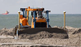 Bulldozer. A Bulldozer on Hollands large Dredging work Maasvlakte royalty free stock photos