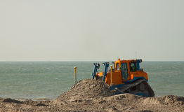 Bulldozer. A Bulldozer on Hollands large Dredging work Maasvlakte royalty free stock photo