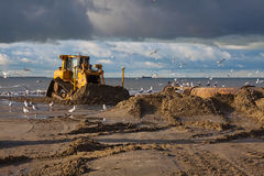 Bulldozer. On a dutch Dredging work in the morning stock photography