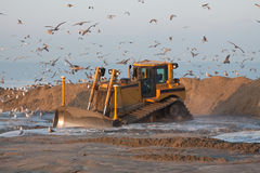 Bulldozer. A Bulldozer on a dutch Dredging work stock photo