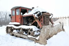 Bulldozer. Parked in the snow Stock Images