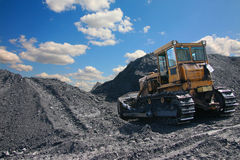 Bulldozer. In the background of coal and the sky Royalty Free Stock Images