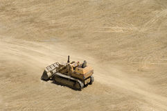 Bulldozer. A bulldozer working on a barren road construction site Stock Photo