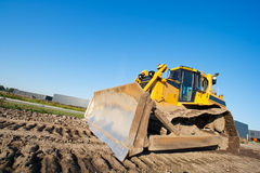 Bulldozer. Yellow bulldozer at work with a clear blue sky Royalty Free Stock Image