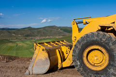 Bulldozer. On the top of the hill Royalty Free Stock Photography