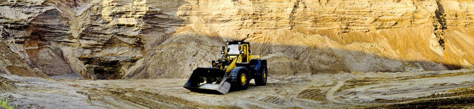 Bulldozer. Excavator, construction machinery, old , loading sand, Masuria, crawler to mine sand Royalty Free Stock Photo