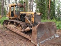 Bulldozer. Yellow bulldozer in the woods Royalty Free Stock Photography