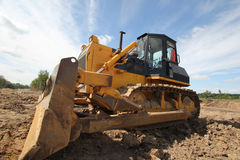 Bulldozer. On a building site Stock Images
