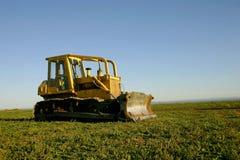 Bulldozer. Yellow bulldozer park in a field Stock Photos